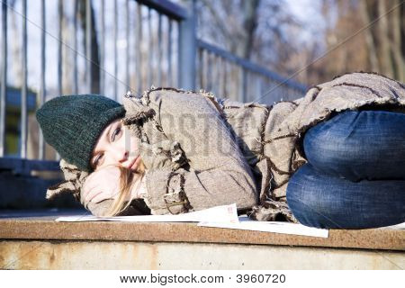 The Young Woman Lying On Asphalt