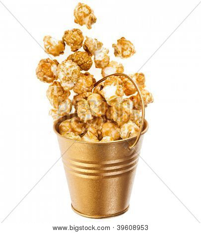 Full bucket box of caramel popcorn dropped isolated on white