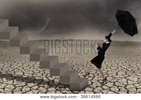 Businesswoman With Umbrealla On Stairs In Stormy Weather