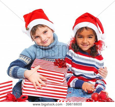 Little kids in Santa's hat with gift box