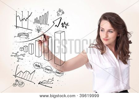 Young business woman drawing various diagrams on whiteboard