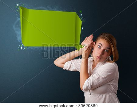 Young woman with modern speech bubble and copy space