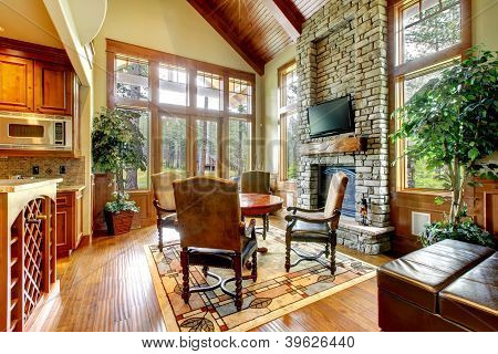Luxury Mountain Home Diining And Living Room With Fireplace.
