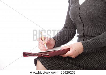 Woman Write By Pen On Paper . Isolated On White Background