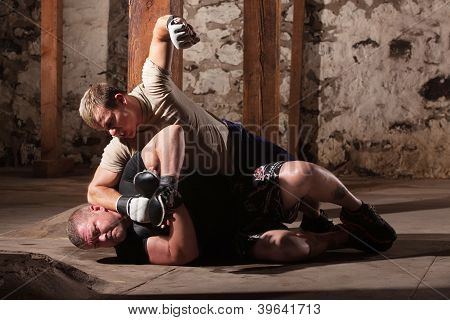 Martial Artist Punching Man On Ground