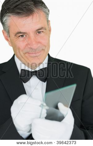 Happy waiter writing on virtual screen on white background