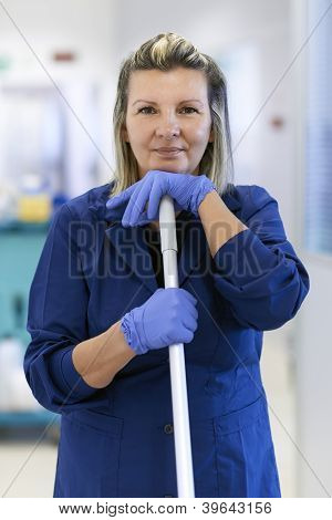 Portrait Of Happy Professional Female Cleaner Smiling In Office