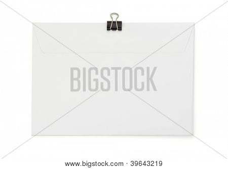 envelope and paper clip isolated on white background