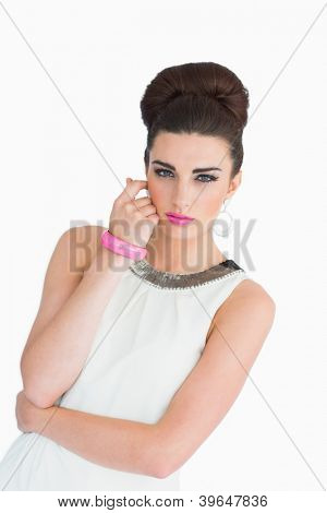 Woman with pink lips and a beehive dressed in the mod style