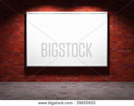 Blank advertising billboard on brick wall at night