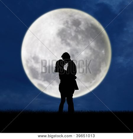 Close Up Of Silhouette Couple Kissing On Full Moon