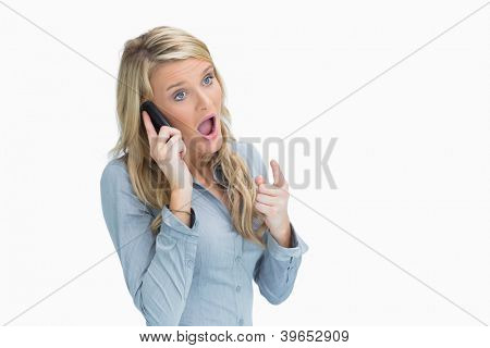 Bonde woman looking shocked on the phone