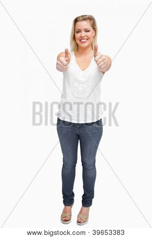Happy blonde woman showing her thumbs up against a white background