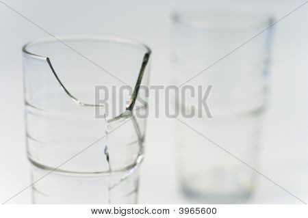 close up of two glasses one broken