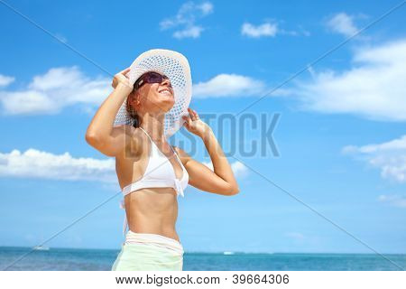 Happy beautiful woman on the beach. Vacation.
