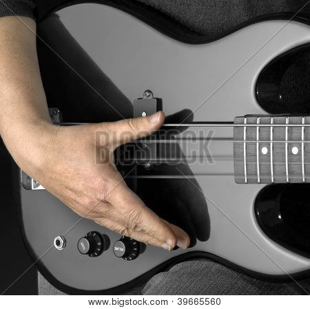 Bass Guitar And Hand