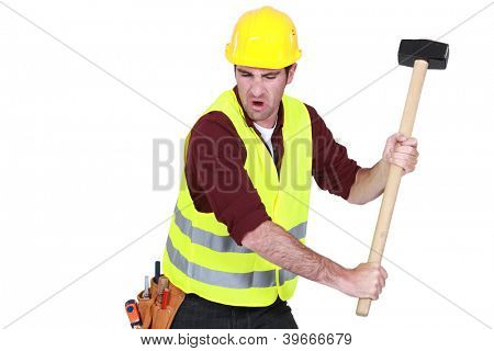 Tradesman hitting an object with a mallet