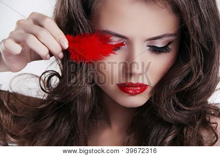 Glamour Portrait Of Beautiful Woman With Red Lips And Feather