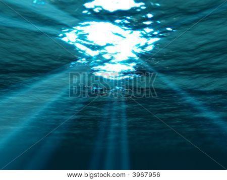 Subaquática, com raio de sol brilhando através da superfície do mar