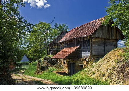 Rural Village With Wooden Cottages