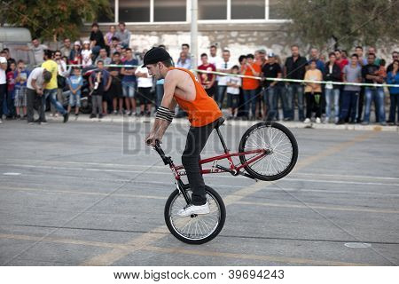 Cyclist Performing Extreme Stand
