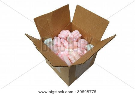 Cardboard box filled with shipping material on white background