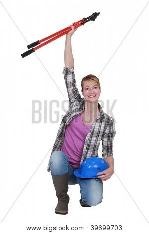 Tradeswoman holding a pair of large clippers in the air
