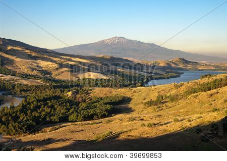 view from Agira on hinterland and Pozzillo Lake, on background volcano Etna