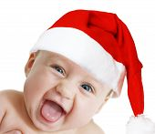 picture of santa baby  - baby in Christmas bonnet looks at camera on white background
