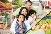 image of grocery-shopping  - Family shopping in supermarket for some fruit and vegetables - JPG