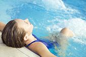 image of hot-tub  - Portrait of young woman sitting in swimming pool - JPG