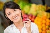 stock photo of local shop  - Woman shopping for groceries at the local market - JPG