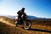 stock photo of moto-x  - close up of moto racer en route - JPG