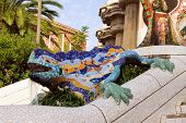 stock photo of gaudi barcelona  - Sculpture of a Dragon salamandra of Antoni Gaudi mosaic in park guell of Barcelona - JPG