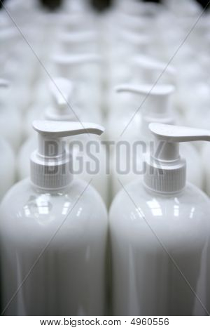 White Plastic Soap Bottles In Rows Assembly Line