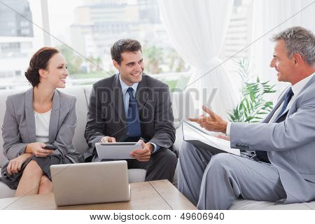 Business people having a meeting in cosy meeting room