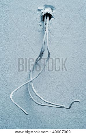 three-phase electrical cables on a wall or a ceiling