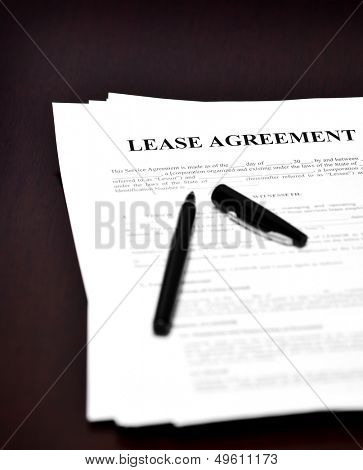 Lease Agreement on desk with black pen waiting to be signed