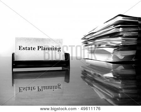 Estate Planning business card on desk with files