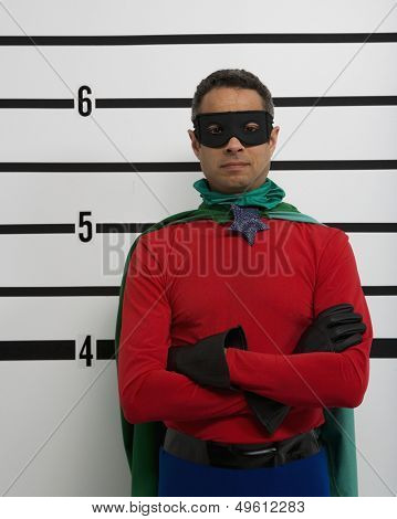 Superhero standing in police line up