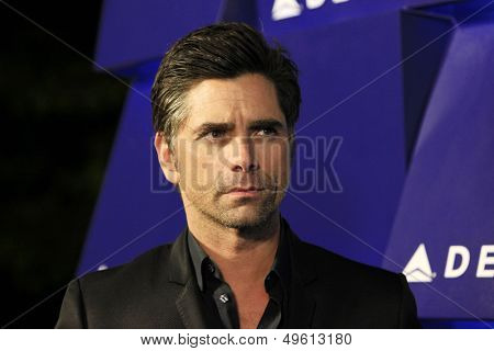 BEVERLY HILLS - AUG 15: John Stamos at a summer celebration hosted by Delta Air Lines at a private residence on August 15, 2013 in Beverly Hills, California
