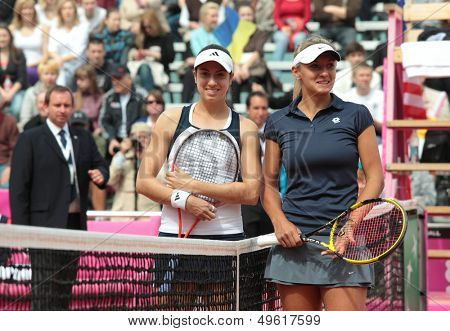 KHARKOV, UKRAINE - APRIL 21: C. McHale, USA, and L. Tsurenko, Ukraine (right) before the match during Fed Cup tie USA vs Ukraine in Superior Golf and Spa Resort, Kharkov, Ukraine on April 21, 2012