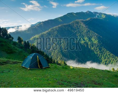 Tent in the hikers camp in mountains