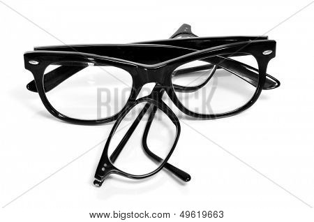two pair of black glasses on a white background