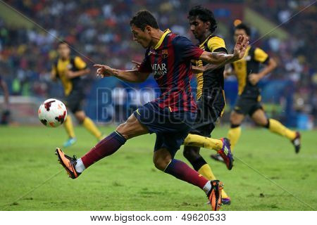 KUALA LUMPUR - AUGUST 10: FC Barcelona's Adriano kicks the ball in a friendly match against Malaysia at the Shah Alam Stadium on August 10, 2013 in Kuala Lumpur, Malaysia. Barcelona wins 3-1.