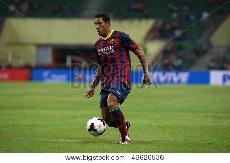 KUALA LUMPUR - AUGUST 10: FC Barcelona's Adriano (maroon/blue) dribbles the ball in a friendly match vs Malaysia at the Shah Alam Stadium on August 10, 2013 in Malaysia. Barcelona wins 3-1.