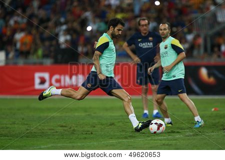 KUALA LUMPUR - AUGUST 9: FC Barcelona's Cesc Fabregas kicks the ball at training at the Bukit Jalil Stadium on August 09, 2013 in Malaysia. FC Barcelona is on an Asia Tour to Malaysia and Thailand.