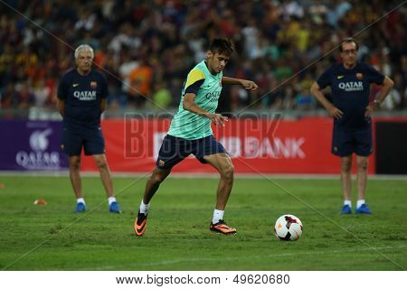 KUALA LUMPUR - AUGUST 9: FC Barcelona's Neymar kicks the ball during training at the Bukit Jalil Stadium on August 09, 2013 in Malaysia. FC Barcelona is on an Asia Tour to Malaysia and Thailand.