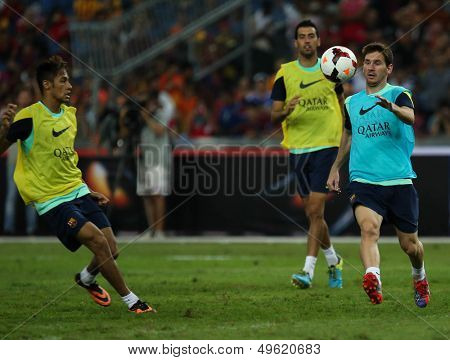 KUALA LUMPUR - AUGUST 9: FC Barcelona's Lionel Messi (blue bib) practices during training at the Bukit Jalil Stadium on August 09, 2013 in Malaysia. FC Barcelona is on an Asia Tour to Malaysia.