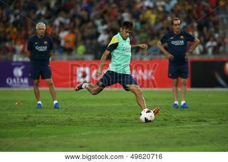 KUALA LUMPUR - AUGUST 9: FC Barcelona's Neymar Jr kicks the ball during training at the Bukit Jalil Stadium on August 09, 2013 in Malaysia. FC Barcelona is on an Asia Tour to Malaysia and Thailand.